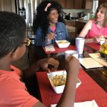 Liz LeBrun shares a meal with her two children, Maria and Andy, at their home in Guelph, Ontario. The children are biological siblings who had never met until Liz adopted them both.